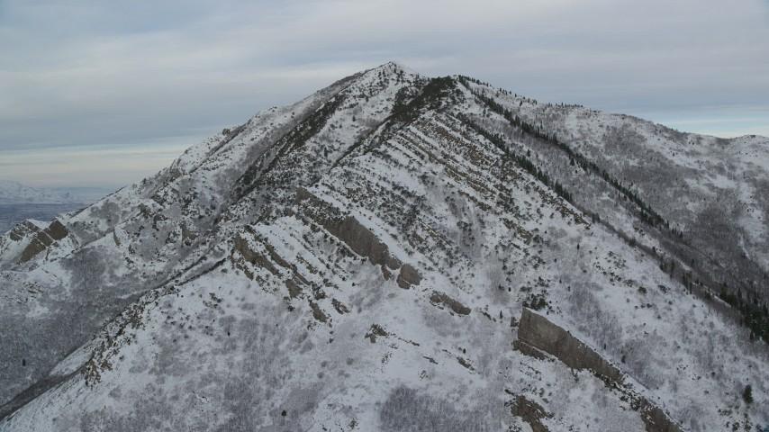 6K stock footage aerial video approach Grandeur Peak with light snow at sunrise in Utah Aerial Stock Footage | AX124_169