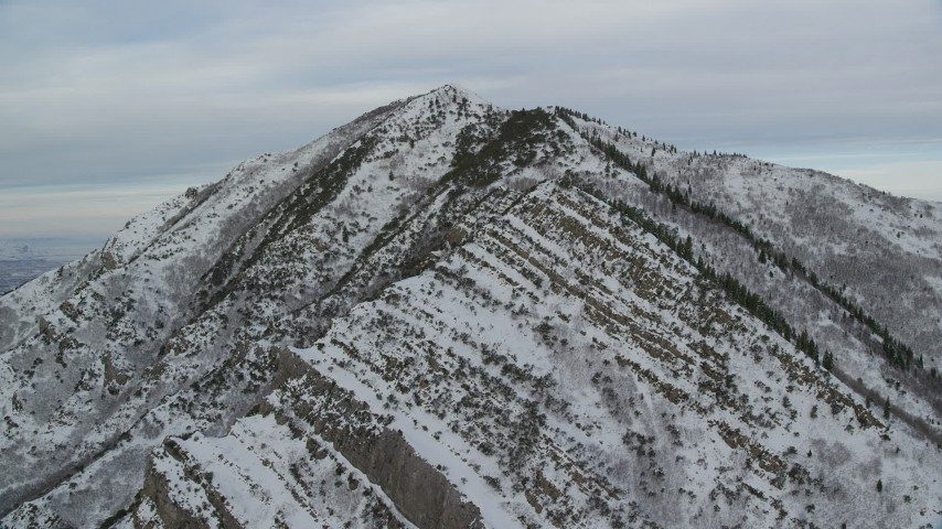 Approaching Snowy Grandeur Peak in the Wasatch Range at Sunrise Aerial Stock Footage | AX124_170