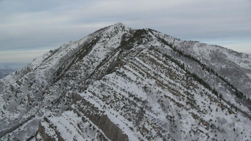 6K stock footage aerial video of approaching snowy Grandeur Peak in the Wasatch Range at sunrise, Utah Aerial Stock Footage | AX124_170