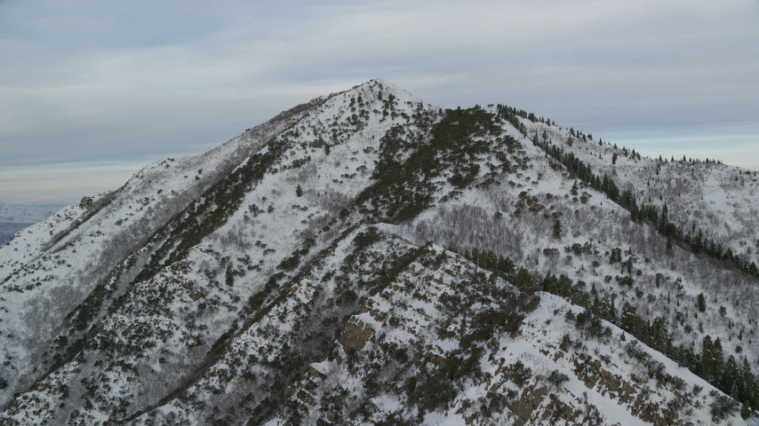 Approach Summit of Grandeur Peak with Winter Snow at Sunrise in Wasatch Range, Utah Aerial Stock Footage | AX124_171