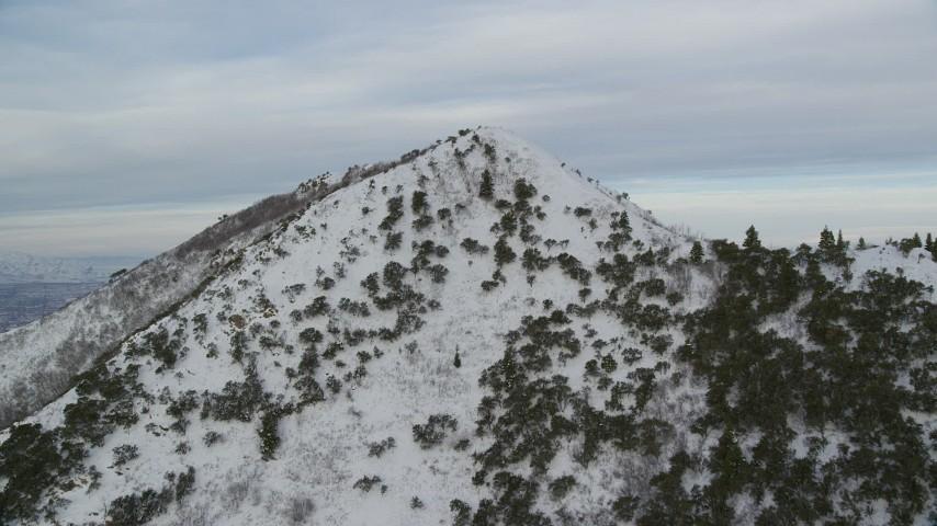 6K stock footage aerial video fly to snowy summit of Utah's Grandeur Peak at sunrise Aerial Stock Footage AX124_173 | Axiom Images