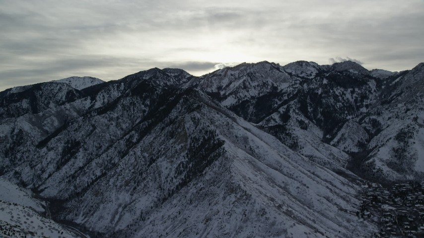 6K stock footage aerial video flyby snow mountains in the Wasatch Range in winter at sunrise in Utah Aerial Stock Footage   AX124_180