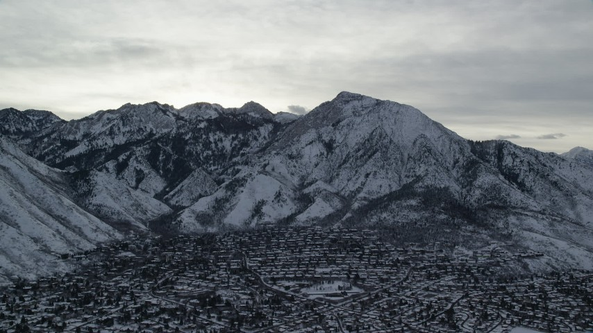 6K stock footage aerial video of Mount Olympus and Salt Lake City suburbs with winter snow at sunrise in Utah Aerial Stock Footage | AX124_182