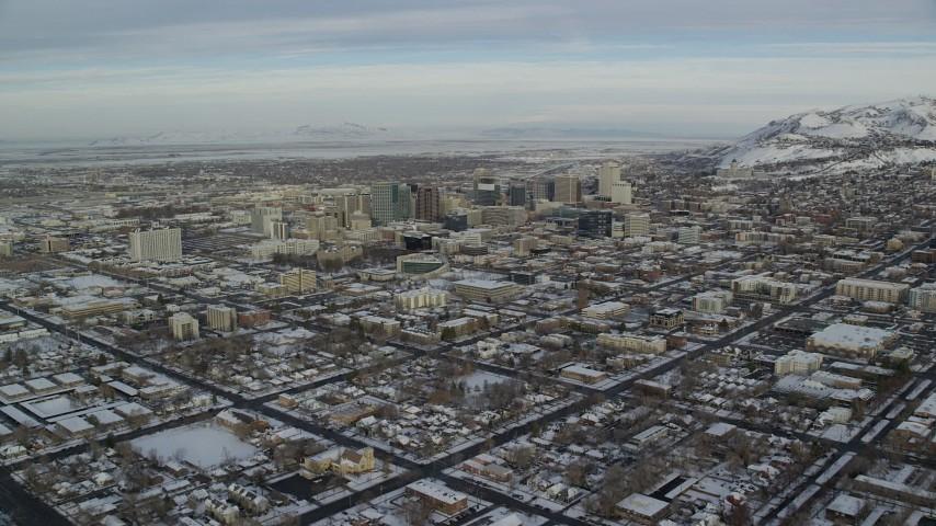6K aerial video approach Downtown Salt Lake City buildings in winter snow at sunrise in Utah Aerial Stock Footage | AX124_194