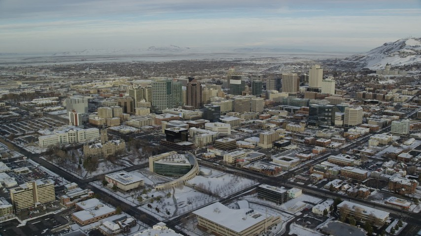6K stock footage aerial video approach wintery Downtown Salt Lake City, Utah with snow at sunrise Aerial Stock Footage | AX124_195