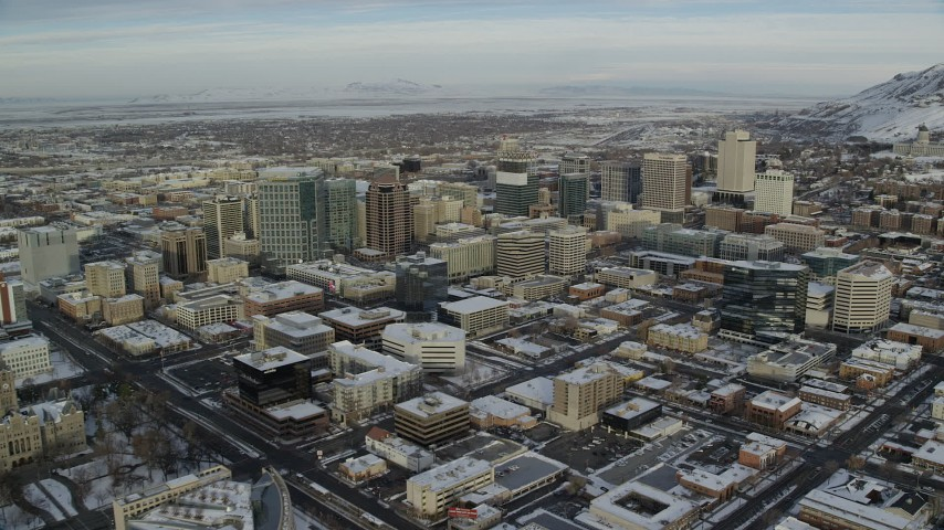 Downtown Salt Lake City Buildings with Winter Snow at Sunrise Aerial Stock Footage | AX124_196