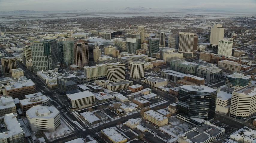 6K stock footage aerial video orbit of Downtown Salt Lake City with winter snow at sunrise in Utah Aerial Stock Footage   AX124_197
