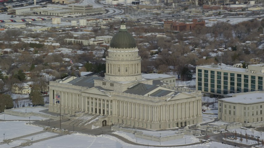 6K stock footage aerial video orbit the Utah State Capitol building with winter snow at sunrise in Salt Lake City Aerial Stock Footage | AX124_199