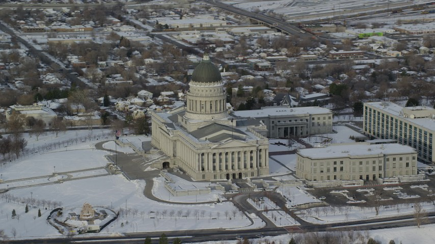 6K stock footage aerial video of orbiting the Utah State Capitol with winter snow in Salt Lake City at sunrise Aerial Stock Footage | AX124_200