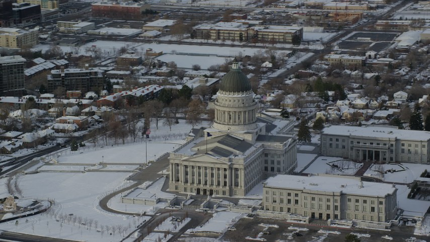 6K stock footage aerial video orbit of the Utah State Capitol with winter snow at sunrise, Salt Lake City Aerial Stock Footage | AX124_201