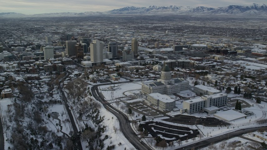 6K stock footage aerial video orbit Utah State Capitol and Downtown Salt Lake City with snow at sunrise Aerial Stock Footage | AX124_202