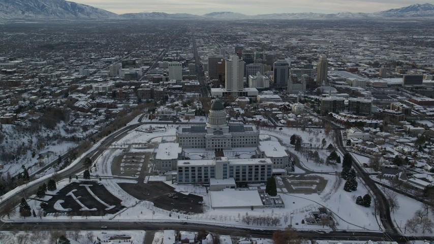 6K stock footage aerial video of orbiting Utah State Capitol and Downtown Salt Lake City with snow at sunrise Aerial Stock Footage | AX124_203