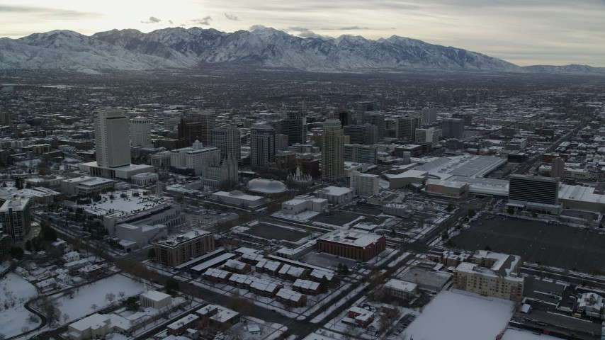 6K stock footage aerial video orbit Downtown Salt Lake City and Salt Lake Temple with snow at sunrise, Utah Aerial Stock Footage | AX124_205