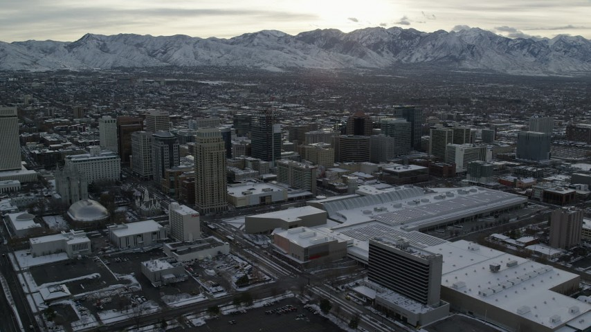 6K stock footage aerial video orbit Downtown Salt Lake City and Salt Lake Temple in winter at sunrise in Utah Aerial Stock Footage | AX124_206