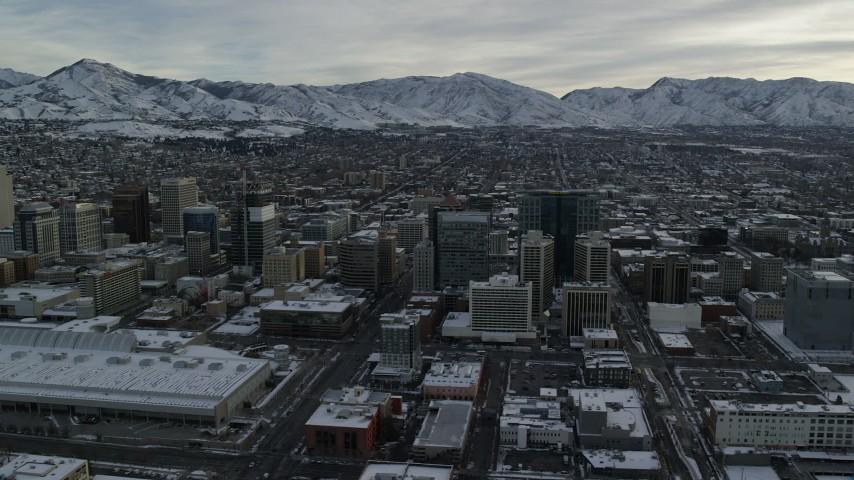 6K stock footage aerial video orbit snowy Downtown Salt Lake City in winter at sunrise, Utah Aerial Stock Footage | AX124_208