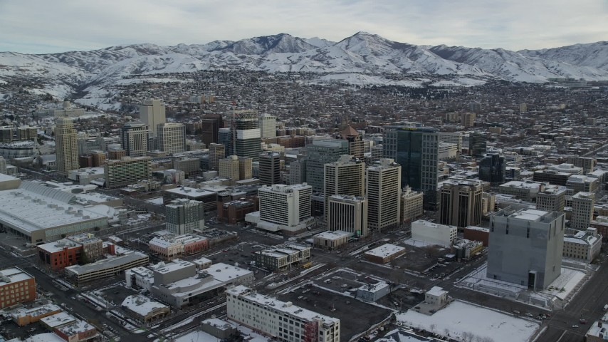 6K stock footage aerial video of circling snowy Downtown Salt Lake City in winter at sunrise in Utah Aerial Stock Footage | AX124_209