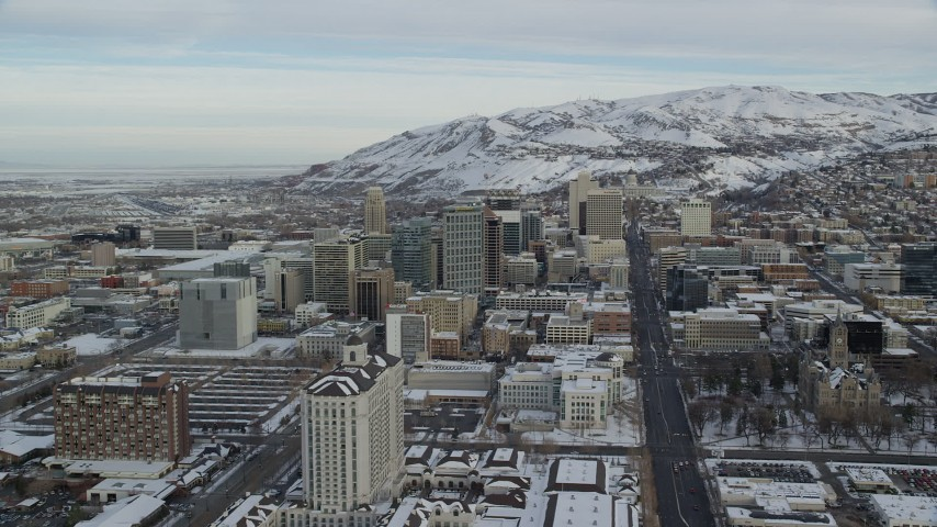 6K stock footage aerial video orbit and approach State Street in Downtown Salt Lake City with snow at sunrise, Utah Aerial Stock Footage | AX124_212