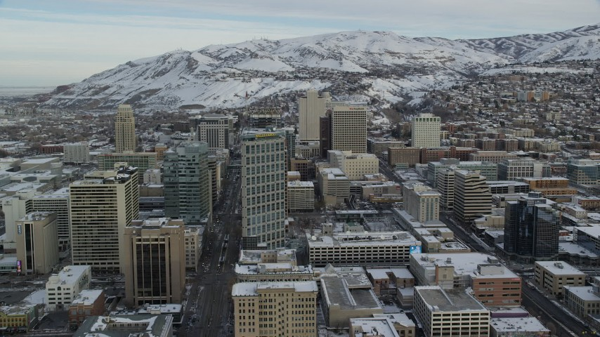Approach Buildings in Downtown Salt Lake City in Winter at Sunrise Aerial Stock Footage | AX124_214