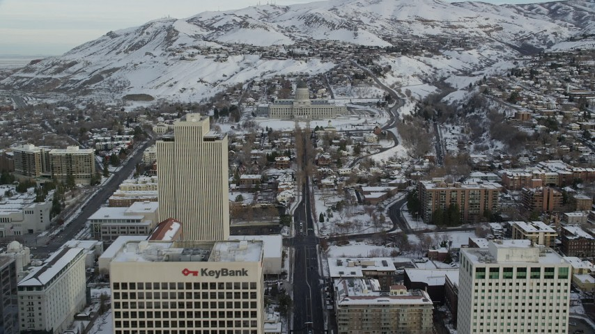 6K stock footage aerial video approach Utah State Capitol from Downtown in winter at sunrise, Salt Lake City Aerial Stock Footage AX124_216 | Axiom Images