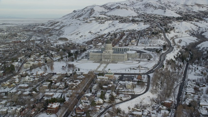 6K stock footage aerial video approach and orbit Utah State Capitol in winter snow at sunrise, Salt Lake City Aerial Stock Footage | AX124_217