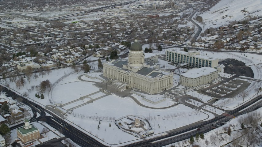 6K stock footage aerial video orbit snowy grounds of Utah State Capitol in winter at sunrise in Salt Lake City Aerial Stock Footage | AX124_218