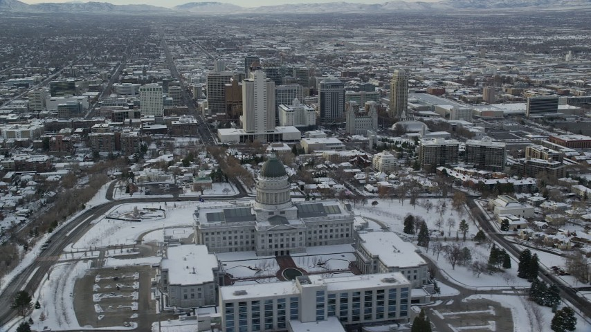 6K stock footage aerial video orbit snowy Utah State Capitol and Downtown Salt Lake City in winter at sunrise Aerial Stock Footage | AX124_220