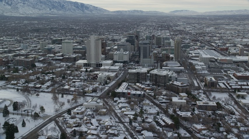 6K stock footage aerial video of Downtown Salt Lake City with winter snow at sunrise, Utah Aerial Stock Footage AX124_221 | Axiom Images