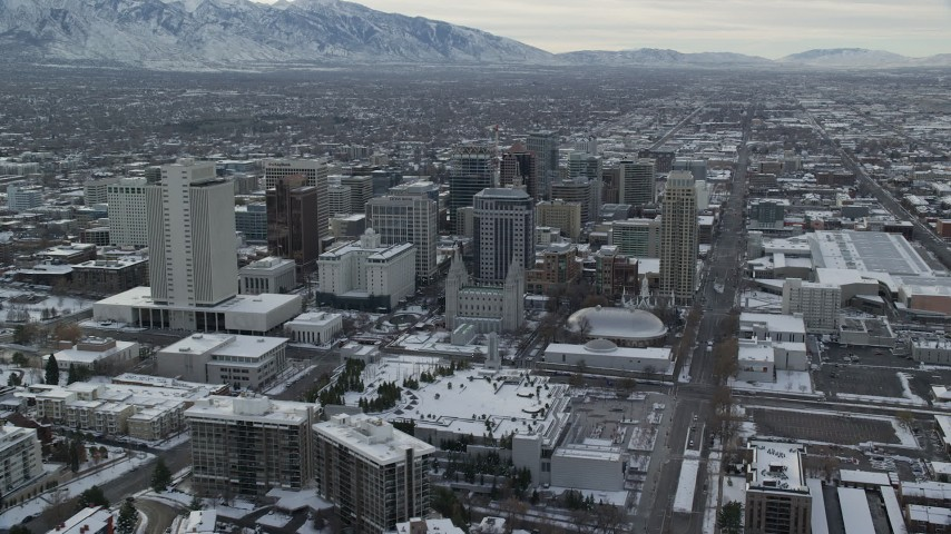 6K stock footage aerial video of Salt Lake Temple and downtown buildings in snowy Salt Lake City at sunrise, Utah Aerial Stock Footage | AX124_222