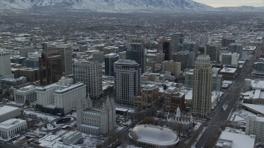 6K stock footage aerial video of Downtown Salt Lake City and Salt Lake Temple in winter snow at sunrise, Utah Aerial Stock Footage | AX124_223