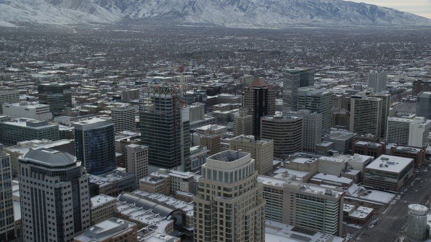 6K stock footage aerial video flyby Downtown Salt Lake City in winter snow at sunrise, Utah Aerial Stock Footage | AX124_224