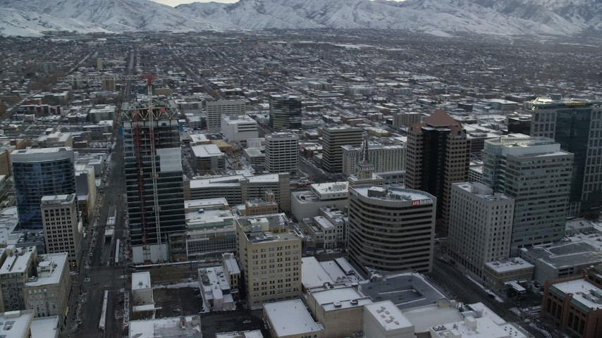6K stock footage aerial video orbit Downtown Salt Lake City and reveal Wasatch Range at sunrise, Utah Aerial Stock Footage | AX124_225