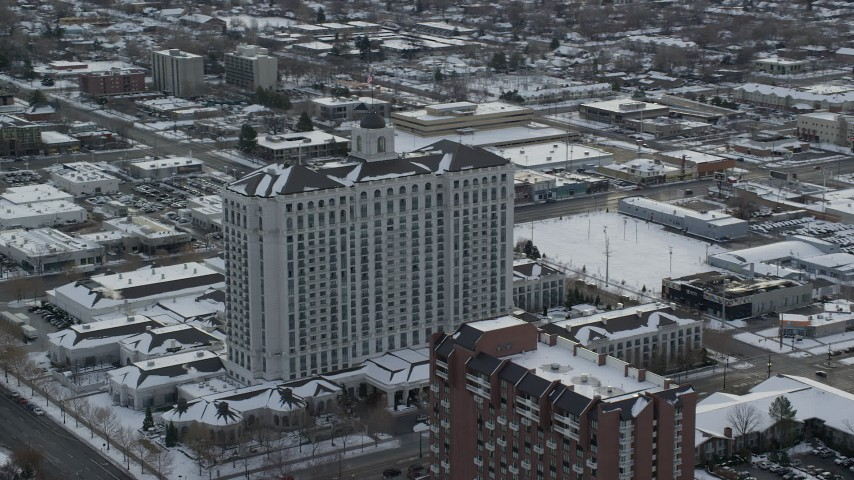 6K stock footage aerial video orbit the Grand America Hotel in Downtown Salt Lake City with winter snow at sunrise, Utah Aerial Stock Footage | AX124_226