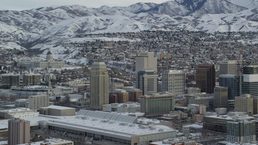 6K stock footage aerial video of Downtown Salt Lake City and Utah State Capitol with winter snow at sunrise Aerial Stock Footage | AX124_227