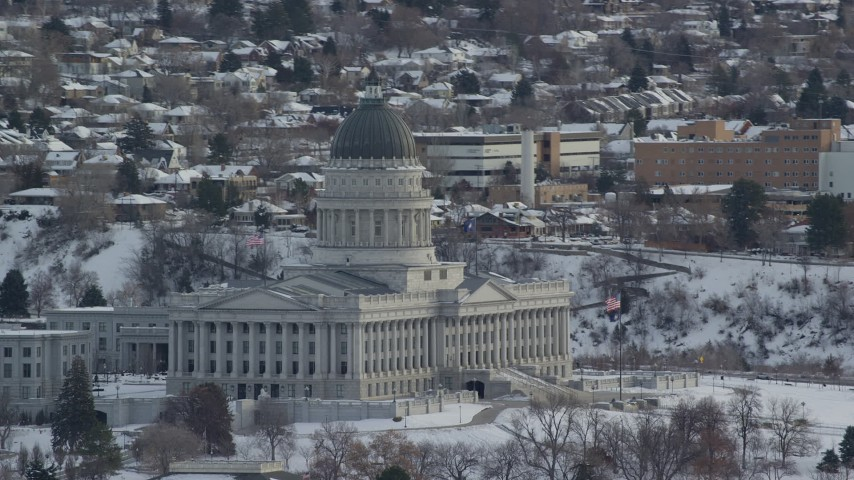 6K stock footage aerial video of circling the Utah State Capitol in snowy Salt Lake City at sunrise Aerial Stock Footage | AX124_229