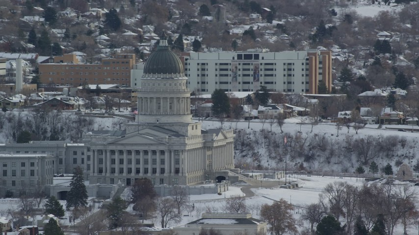 6K stock footage aerial video orbit of the Utah State Capitol in wintery Salt Lake City at sunrise Aerial Stock Footage | AX124_230