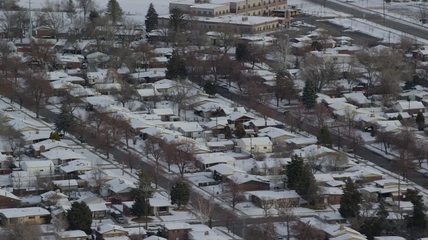 6K stock footage aerial video orbit Salt Lake City suburbs with snow at sunrise, Utah Aerial Stock Footage | AX124_232