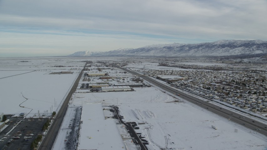 6K stock footage aerial video of warehouse buildings in snowy Salt Lake City at sunrise in Utah Aerial Stock Footage | AX124_234