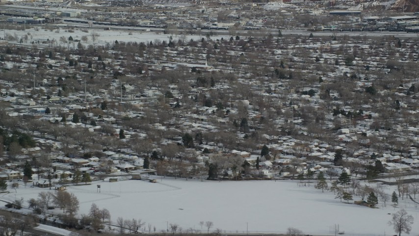 6K aerial video of snowy Salt Lake City suburban homes in winter, Utah Aerial Stock Footage | AX125_003