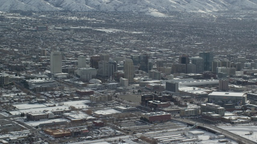 6K stock footage aerial video of panning across Downtown Salt Lake City with winter snow, Utah Aerial Stock Footage | AX125_005