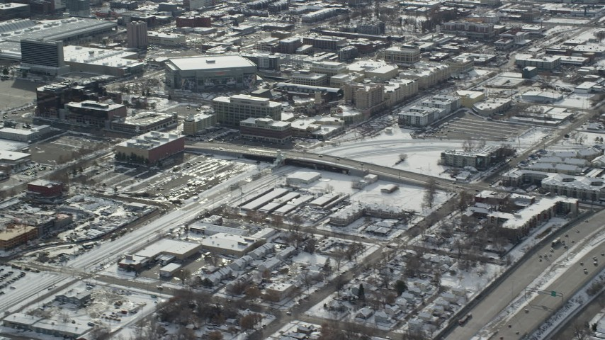 6K stock footage aerial video tilt from freeway to reveal Downtown Salt Lake City with winter snow, Utah Aerial Stock Footage | AX125_006