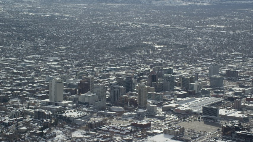 6K stock footage aerial video of Downtown Salt Lake City with winter snow in Utah Aerial Stock Footage | AX125_007