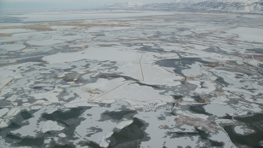 6K aerial video of frozen marshlands near Salt Lake City in wintery Utah Aerial Stock Footage | AX125_019