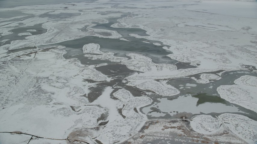 6K stock footage aerial video flyby ice and snow in frosty marshland near Salt Lake City, Utah Aerial Stock Footage | AX125_022