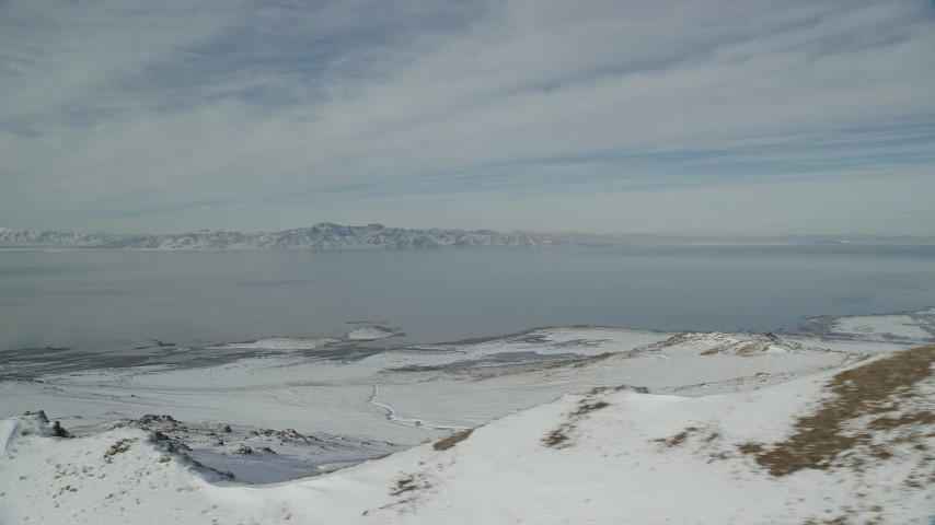Great Salt Lake and the Frozen Shore of Antelope Island in Winter Aerial Stock Footage | AX125_041