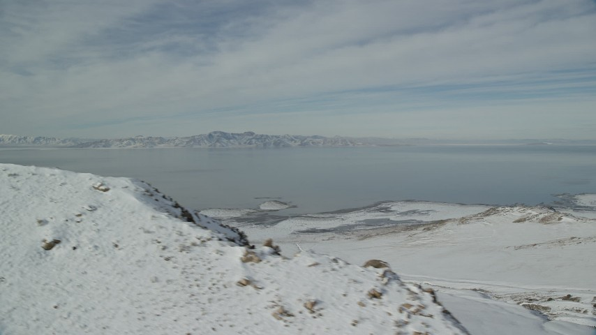 Snowy Shore of Antelope Island and Great Salt Lake in Wintertime Aerial Stock Footage | AX125_042