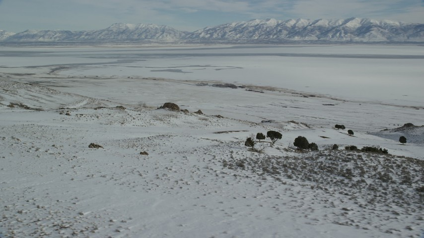 Orbit Sheets of Ice on the Great Salt Lake seen from Antelope Island Aerial Stock Footage | AX125_085
