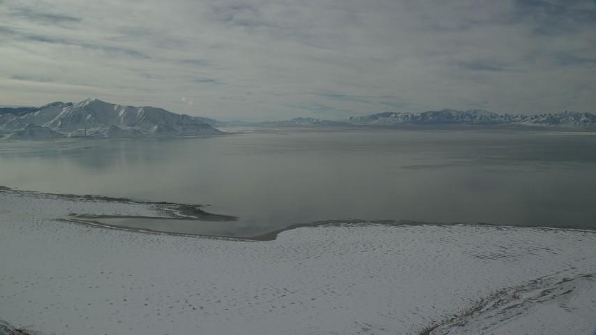 6K stock footage aerial video of the Great Salt Lake seen from Antelope Island in winter, Utah Aerial Stock Footage | AX125_099