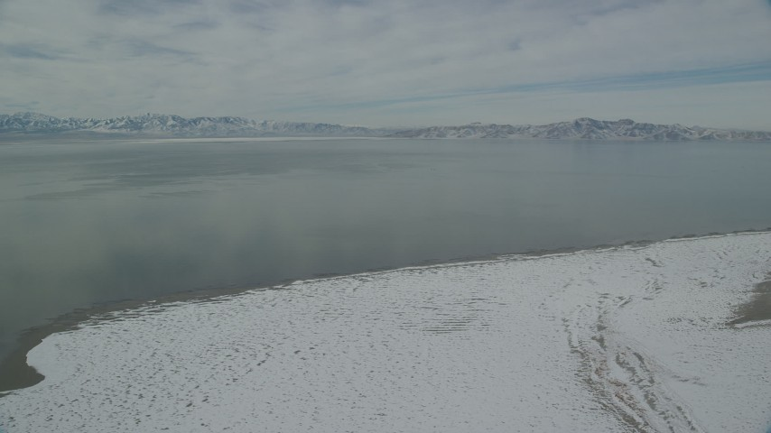 6K stock footage aerial video of Great Salt Lake with patches of ice seen from Antelope Island in winter, Utah Aerial Stock Footage | AX125_100