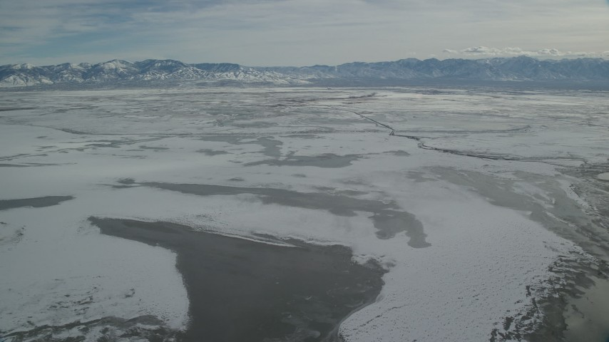Orbiting Frozen Marshlands Outside of Salt Lake City in Winter Aerial Stock Footage | AX125_104