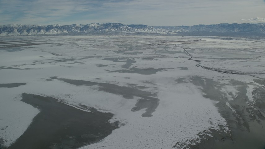 6K stock footage aerial video of ice and frozen marshlands near Salt Lake City in winter, Utah Aerial Stock Footage | AX125_105